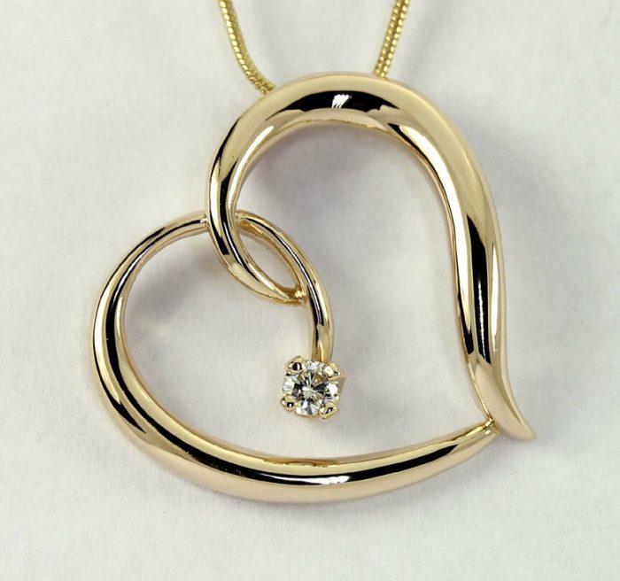 Diamond sculptured heart pendant necklace